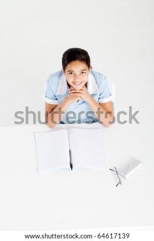 overhead view of a schoolgirl studying homework