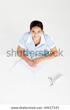 overhead view of a schoolgirl studying homework