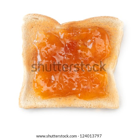 Overhead view of a slice of white toast topped with vibrant orange apricot or peach jam