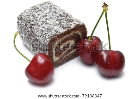 Overhead view of coco roll bar and cherries isolated on white