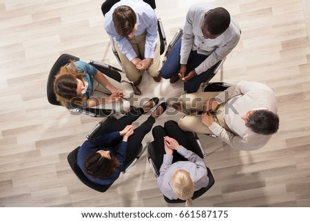 Overhead View Of Diverse People Sitting On Chair In Circle