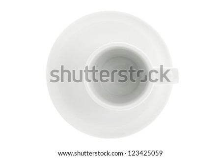 Overhead view of empty mug and saucer over white background - stock photo