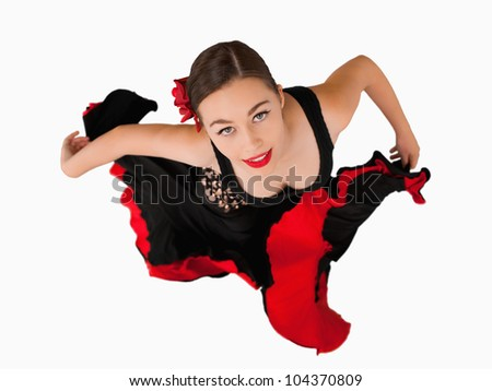 Overhead view of female dancer against a white background