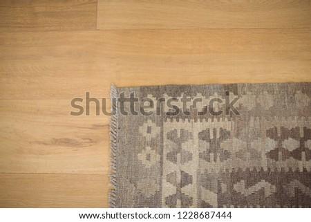 Overhead view of floor mat on wooden floor at home