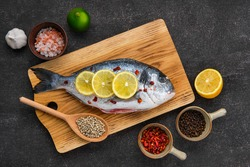 Overhead view of gilt head bream with spice prepared for cooking