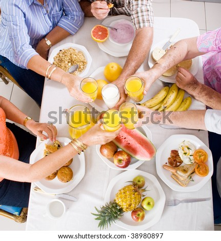 overhead view of group of people having breakfast