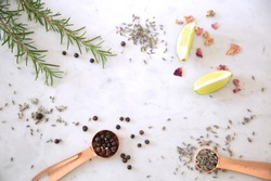 Overhead view of ingredients for cocktails on marble table