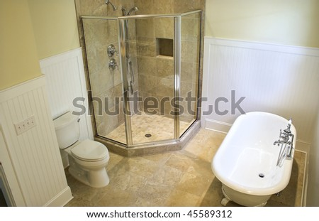 overhead view of luxury bathroom with clawfoot tub and shower