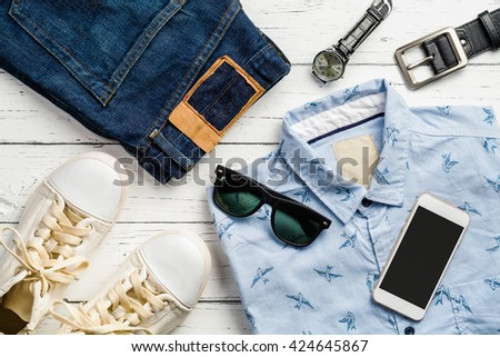 Overhead view of men\'s casual outfits, Outfits of traveler, boy, male, Men\'s casual outfits on wood board background