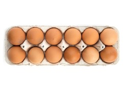 overhead view of one dozen brown eggs in a cardboard egg carton isolated on white