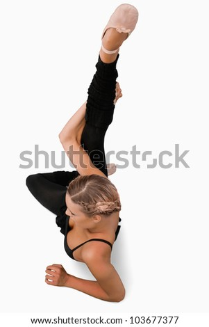 Overhead view of stretching dancer against a white background