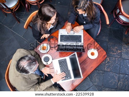 external image stock-photo-overhead-view-of-three-business-people-meeting-in-a-cafe-22539928.jpg