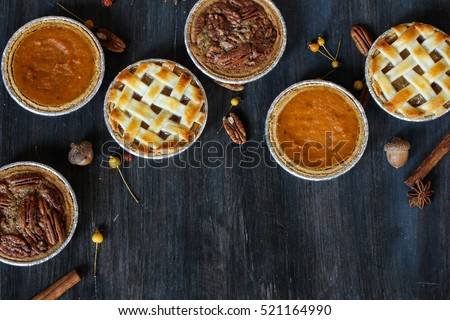 Overhead view of three mini  pies - apple pumpkin  and pecan pies  / Thanksgiving Desserts #521164990