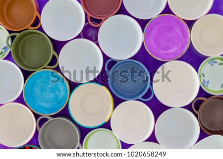 Overhead view of tightly packed assorted empty clean cups in a concept of hunger or thirst in a full frame background Сток-фото ©
