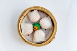 Overhead view of tradition Chinese prawn dumplings placed in a bamboo steamer