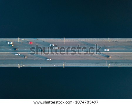 Overhead view of traffic with cars, taxis, bus on a North Bridge in Kyiv city #1074783497
