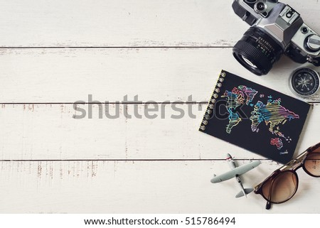 Overhead view of Traveler's accessories and items with black notebook and copy space, Travel concept #515786494