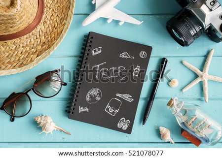 Overhead view of Traveler's accessories and items with copy space on wooden background, Travel concept - Shutterstock ID 521078077