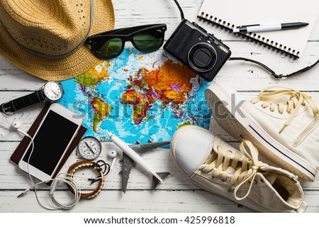 Overhead view of Traveler's accessories, Essential vacation items, Travel concept background #425996818