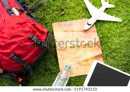 Overhead view of Traveler's accessories such as backpack bag,World Map and travelling items. Destination travel and tourist concept. #1191743110