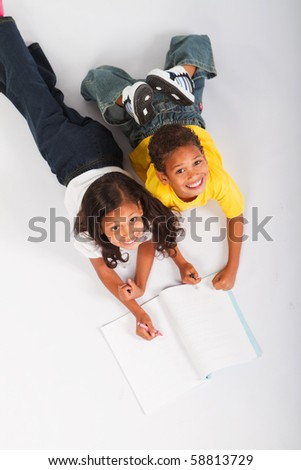 overhead view of two african american kids reading book