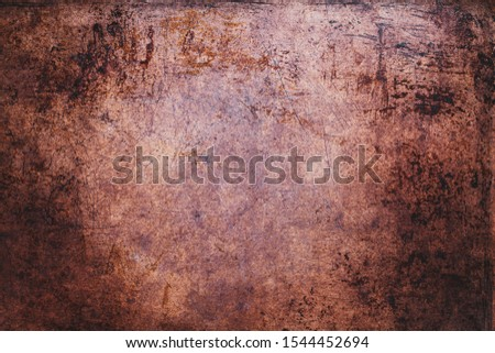 Overhead view scratched grunge sheet of copper metal. Texture with light vignetting.  #1544452694