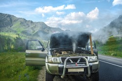 overheated car in the field, bright sunlight, steam under the hood. smoking engine in SUV car. Smoke coming out from overheat engine. Waiting car tow service. Mountain Altai, Russia