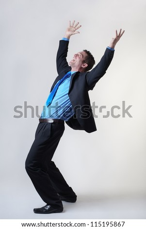 overjoyed business man expring his happiness