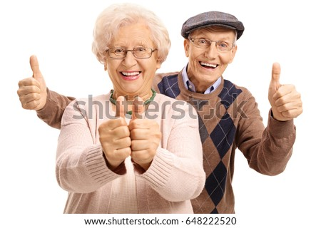 Overjoyed seniors holding their thumbs up isolated on white background #648222520