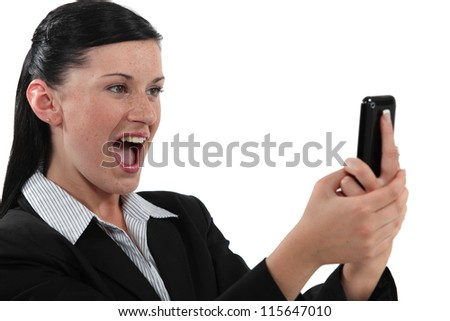 Overjoyed woman reading a text message