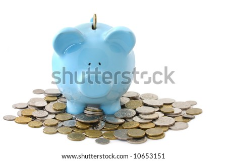 Overloaded blue piggy bank, surrounded by gold and silver coins.