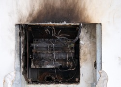 Overloaded electrical circuit cause. Damaged circuit breaker became the cause of electrical short circuit. Bad electrical wiring systems caused fire inside electrical box