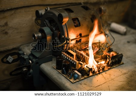 Overloaded electrical circuit causing electrical short and fire. Short circuit faults burnt consumer unit.