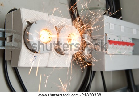 Overloaded electrical circuit causing fuse to break