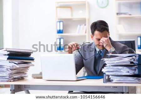 Overloaded with work employee under paperwork burden