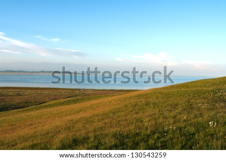 Overlook Qinghai lake and grassland under sunset