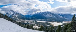 Overlook view Town of Banff in snowy winter season. Snow Capped Mount Rundle, Sulphur Mountain in background. View from Mount Norquay Banff View Point. Banff National Park, Canadian Rockies, Canada.
