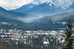 Overlook view Town of Banff in snowy winter season. View from Mount Norquay Banff View Point. Banff National Park, Canadian Rockies, Canada.
