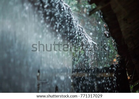Overlooking a roof with raindrops during heavy rainfall