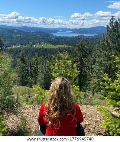 Overlooking Lake Coeur d'Alene in Idaho after hiking up the hills; spring day with beautiful blue skies and white clouds; mountains and greenery in the distance Photo stock ©