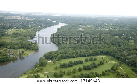 Overlooking lush green trees and land near a body of water