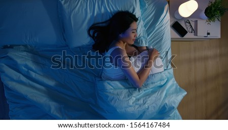 overlooking of asian woman sleep well with smile at night