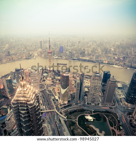 overlooking shanghai at dusk from world financial center