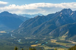 Overlooking Vermilion Lakes and surrounding Canadian Rocky Mountains in summer time. Banff National Park beautiful landscape. Alberta, Canada.