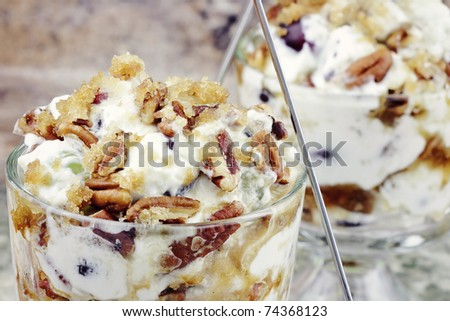 Overnight Grape Salad. Green and red grapes in a creamy rich sauce topped with pecans and brown sugar.
