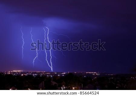 Overnight Lightning Storm. Storm Over City. Few Lightning Strikes. Stormy Overnight Weather in Colorado Springs Metro Area. Horizontal Photo.
