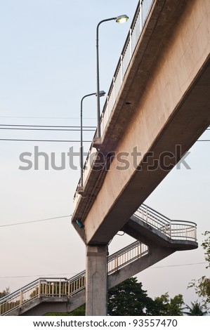 Overpass across the street with lamp poles