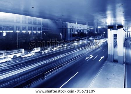 Overpass at night, heavy traffic.
