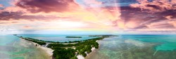 Overseas Highway and Florida Keys coastline, aerial sunset view.
