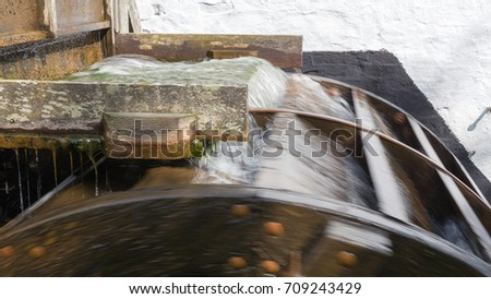 overshot waterwheel in operation